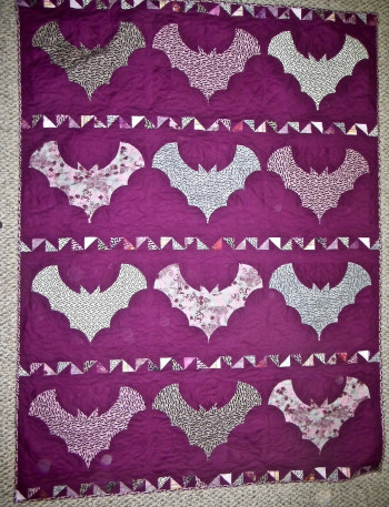 """Pink and Gray Bats Quilt 52"""" by 72"""" - Product Image"""